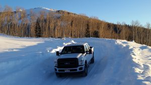 truck in deep snow on the geyser pass road la sal mountains utah