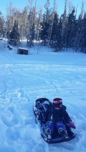 Sledding near the last remaining structure at Blue Mountain Resort