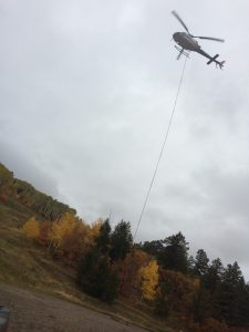 Helicopter removing the old lifter towers from blue mountain ski resort
