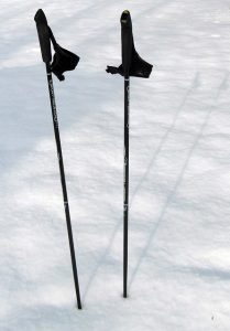 cross country ski poles in snow